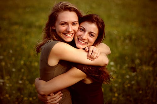 Women hugs each other and smiling