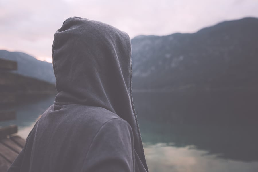Man with hood Looking at the mountain