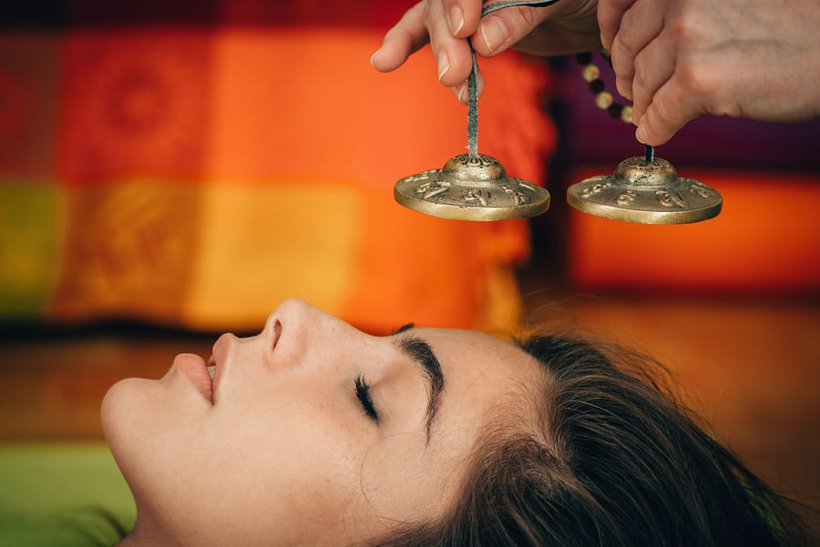 woman-receiving-Tibetan-Bells-In-Sound-Therapy
