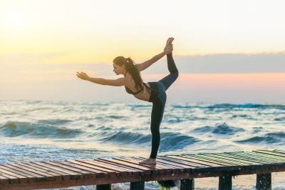 woman-doing-yoga-by-the-beach-during-intensive-outpatient-program