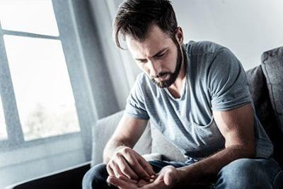 man-sitting-with-drugs-seeking-drug-rehabilitation